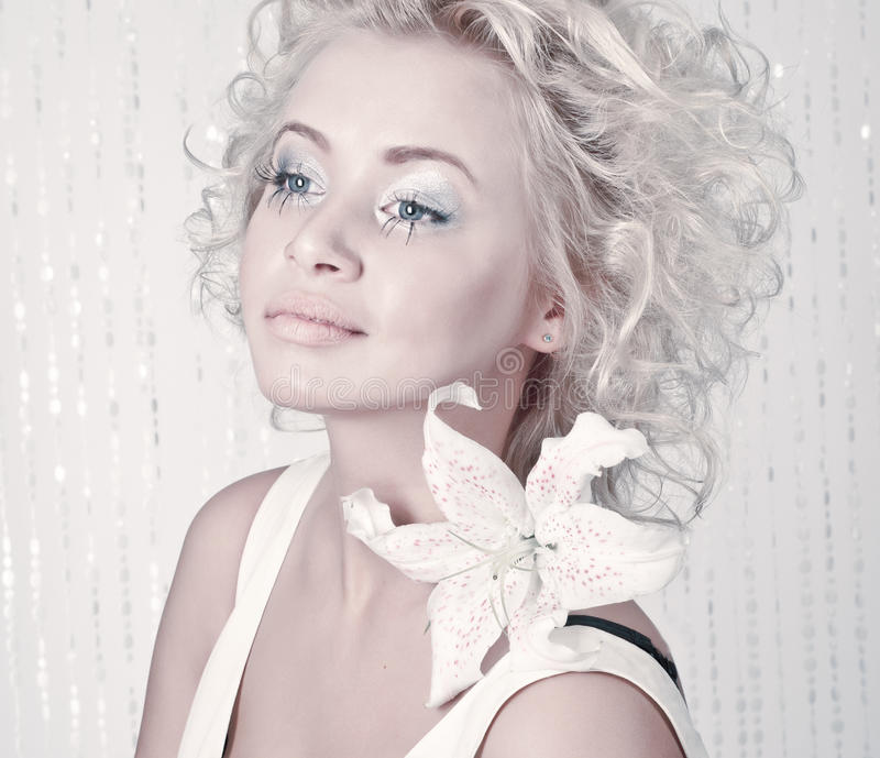 Beautiful Female With Original Make Up And Flower Royalty Free Stock Image