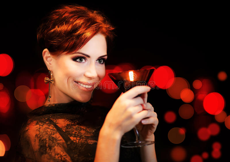 Beautiful female partying, celebrating holiday stock photography