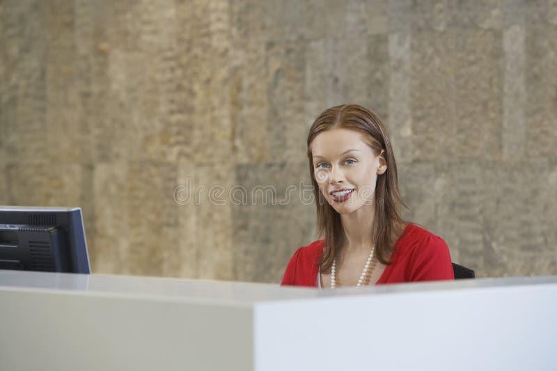 Beautiful Female Receptionist stock image