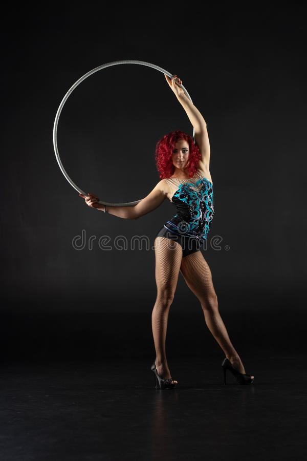 Beautiful female red hair circus artist with a hoop stock photography