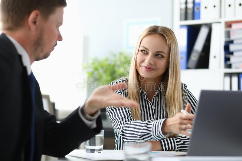 Beautiful female replying for questions stock photos
