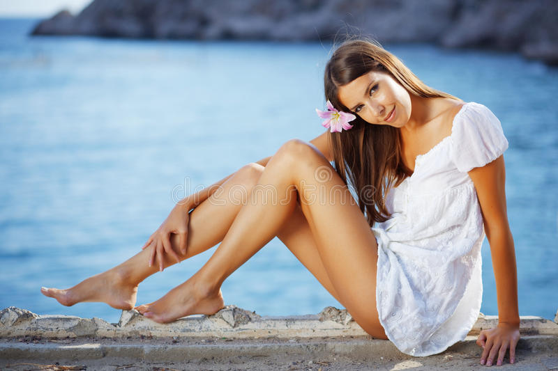 Beautiful female with slim legs stock images