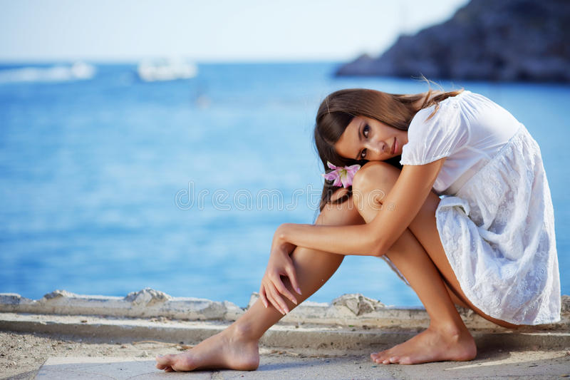 Download Beautiful Female With Slim Legs Posing Over Sea Stock Photo - Image: 10990706