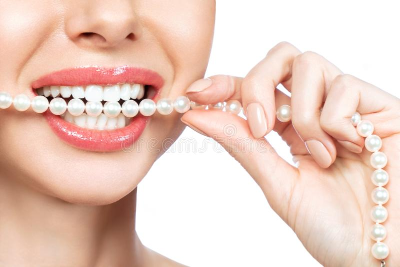 Beautiful female smile and pearl necklace, Dental Health Concept.  stock photos