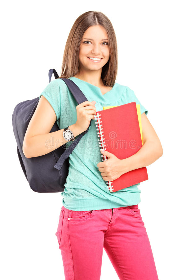 Beautiful female student holding a notebook stock photography