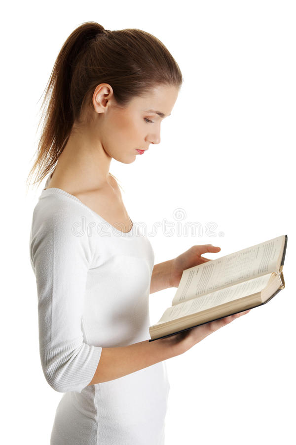 Teenage Caucasian Girl15 Years Old Sitting Outdoors: Beautiful Female Teen With A Book. Royalty Free Stock