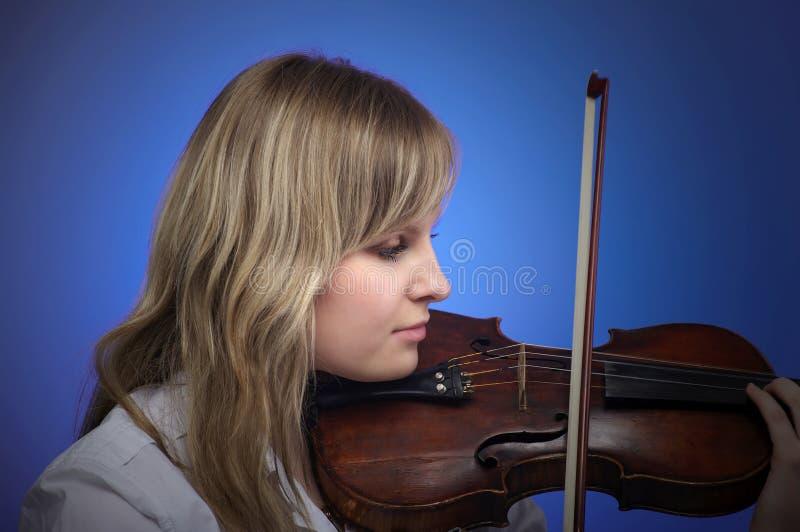 Beautiful female violinist royalty free stock image