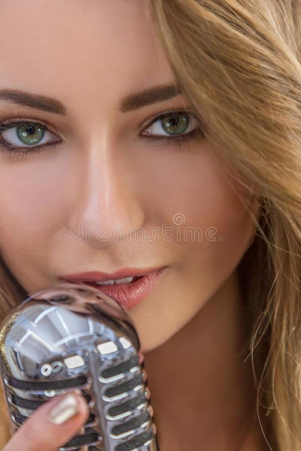 Female Woman Singing With Vintage Microphone royalty free stock images