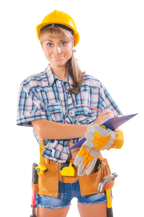 beautiful female worker wearing sleeveless shirt with many construction tools writing in clipboard and looking at camera isolated royalty free stock photos