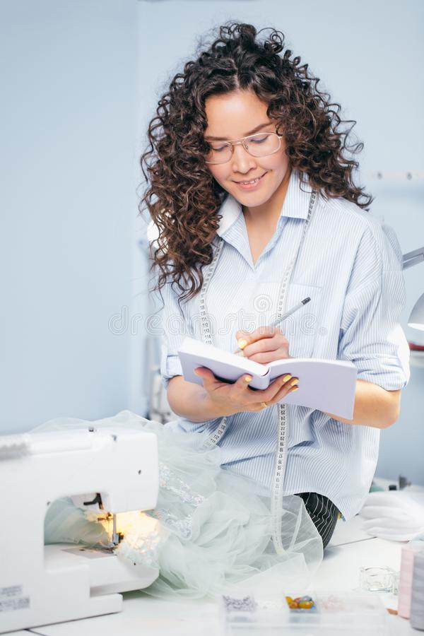 Female writing measures on white notebook indoors royalty free stock photos