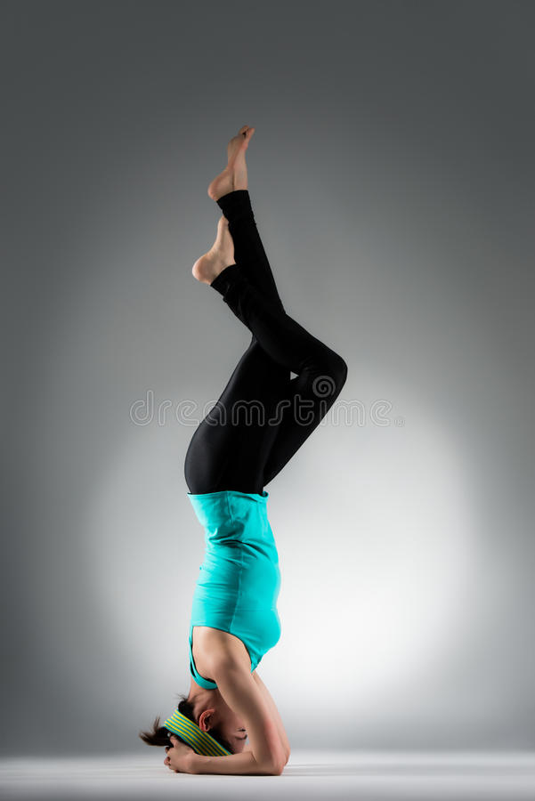 Beautiful yoga teacher making fitness posture stock photos