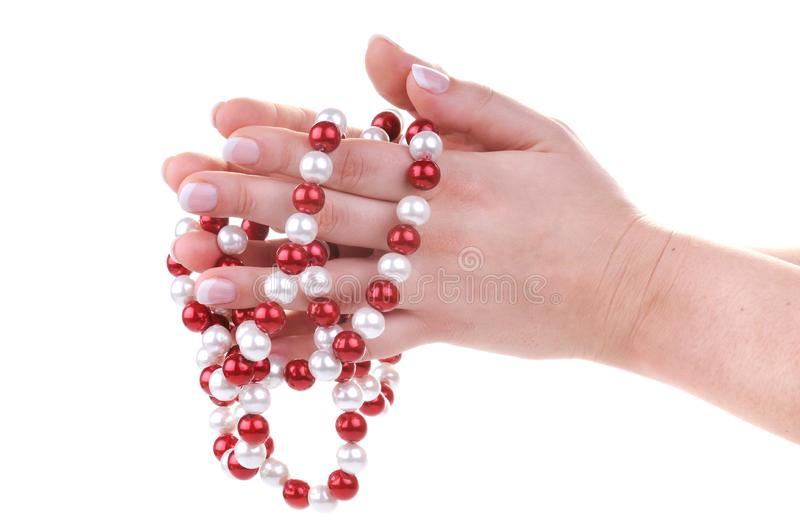 Beautiful feminine hands with necklace