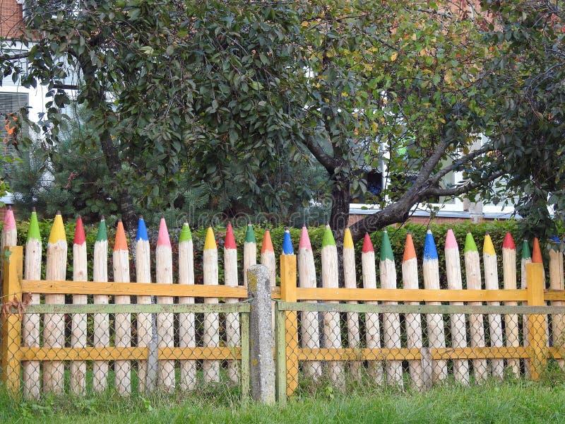 Handmade big wooden pencils - fence, Lithuania. Beautiful fence made from colorful big wooden pencils stock image
