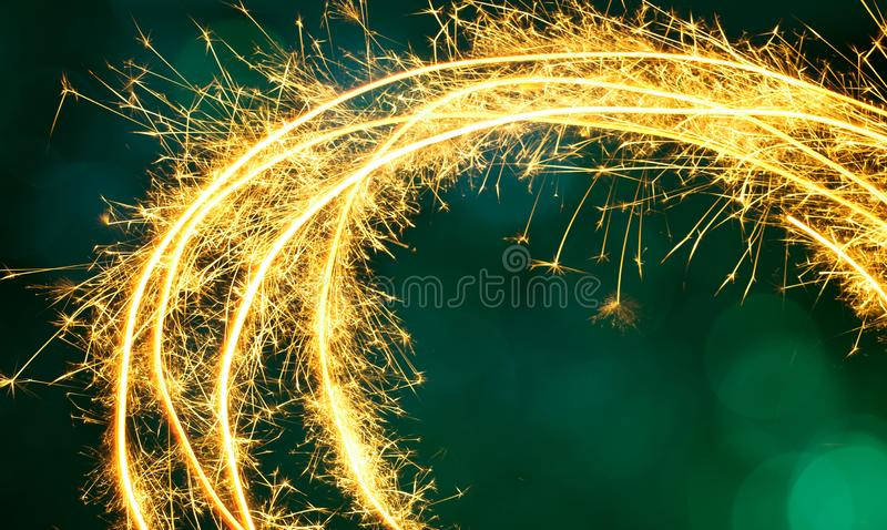 Beautiful green Festive Background with Frame of Sparkling spark. Beautiful Festive Background. Frame of Sparkling sparkler on green background. Holiday Template royalty free stock photo