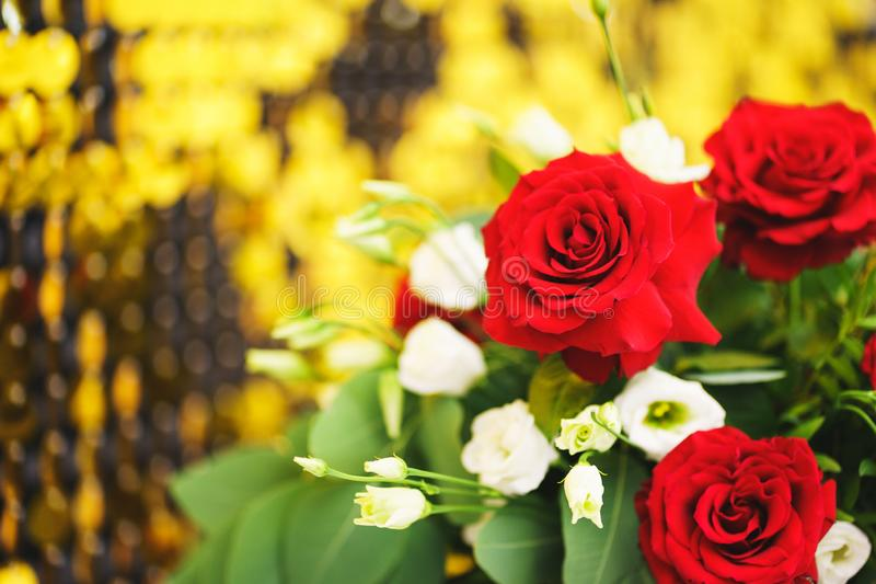 Beautiful festive bouquet close-up. Bright bouquet with red roses as a gift. royalty free stock photos