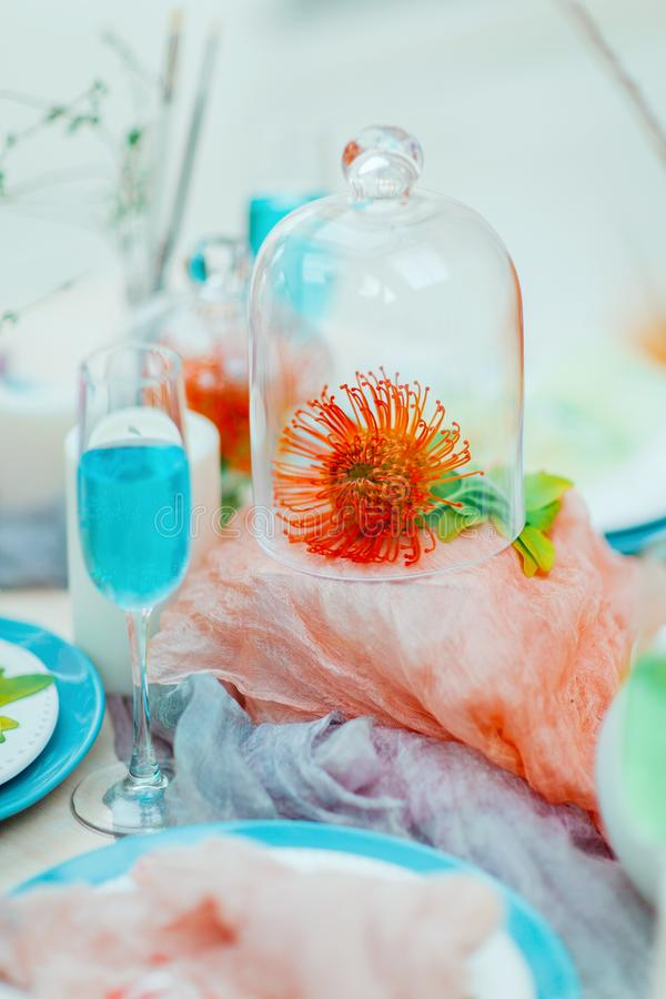 Beautiful festive table decor in a modern style. Concise and colorful. Beautiful festive table decor in a modern style. Concise, bright and colorful royalty free stock photo
