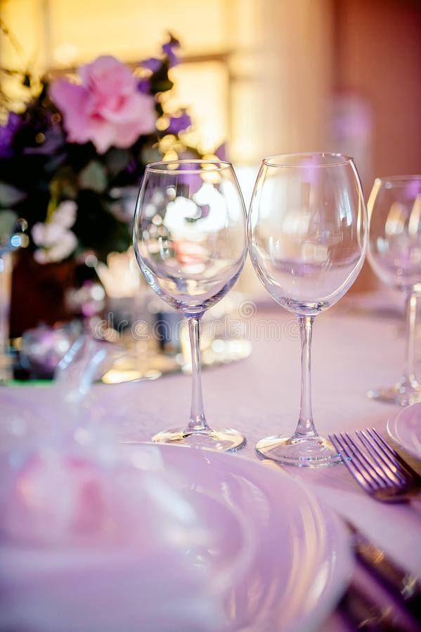 Beautiful festive table setting. With elegant white flowers and cutlery, dinner table decoration royalty free stock images