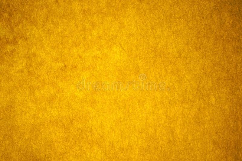 The Golden color of the feast of the fibrous background of abstraction. royalty free stock image