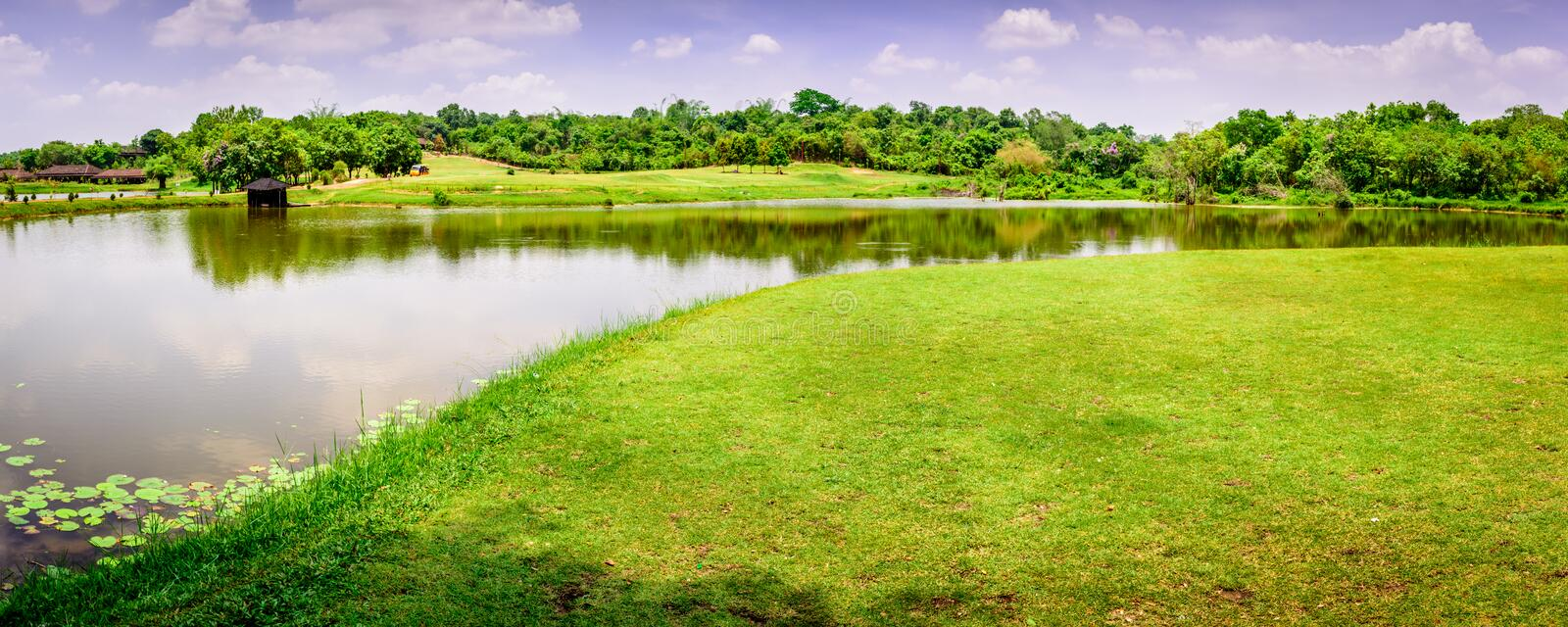 Landscape photo of beautiful scenery with lake, grass field and hill, near Yangon, Myanmar stock image