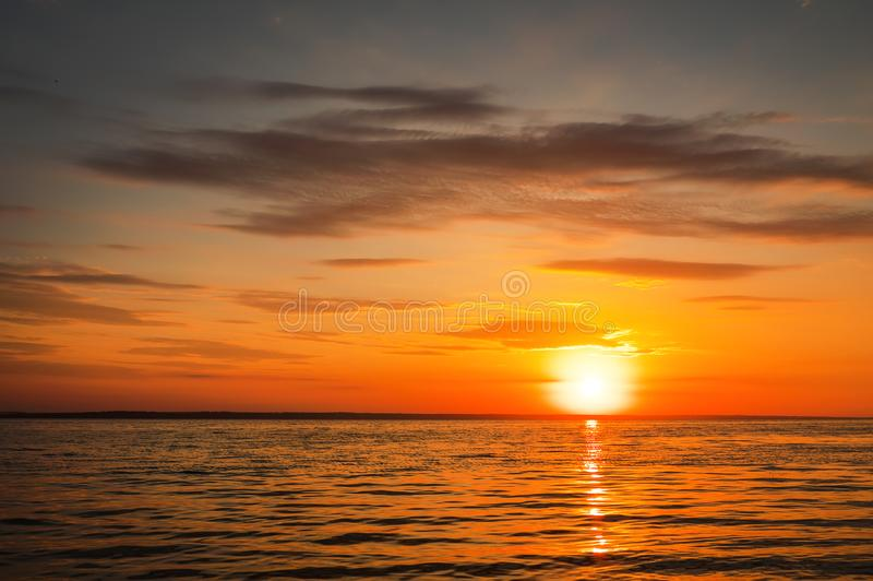 Beautiful fiery sunset sky on the beach. Composition of nature royalty free stock image