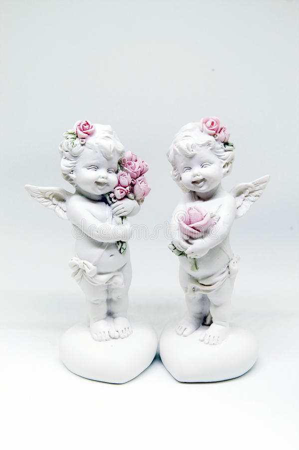 Beautiful figurine in the form of an angel. On white background royalty free stock photos