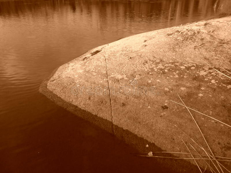 Beautiful Finland Savonlinna summer sunset rock sepia royalty free stock images