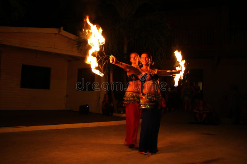 The Flaming Gypsies performing. Two members of Kiki and The Flaming Gypsies brandishing flaming torches during Jump Up in Christiansted, St. Croix, United States stock photo