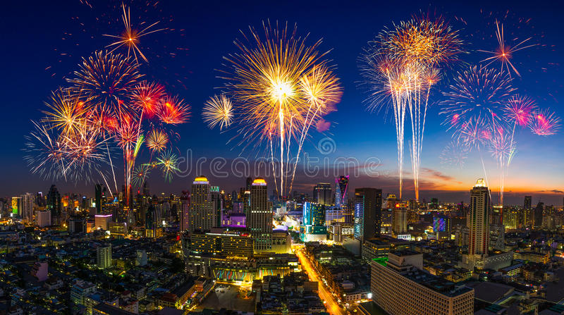Beautiful firework in festival event exploding over the cityscape at twilight scene stock image