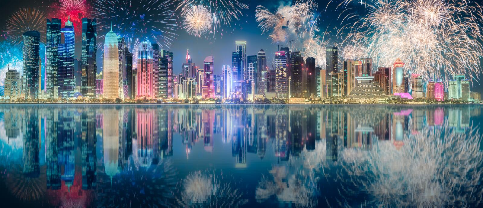 Beautiful fireworks above park in Doha City Center stock images