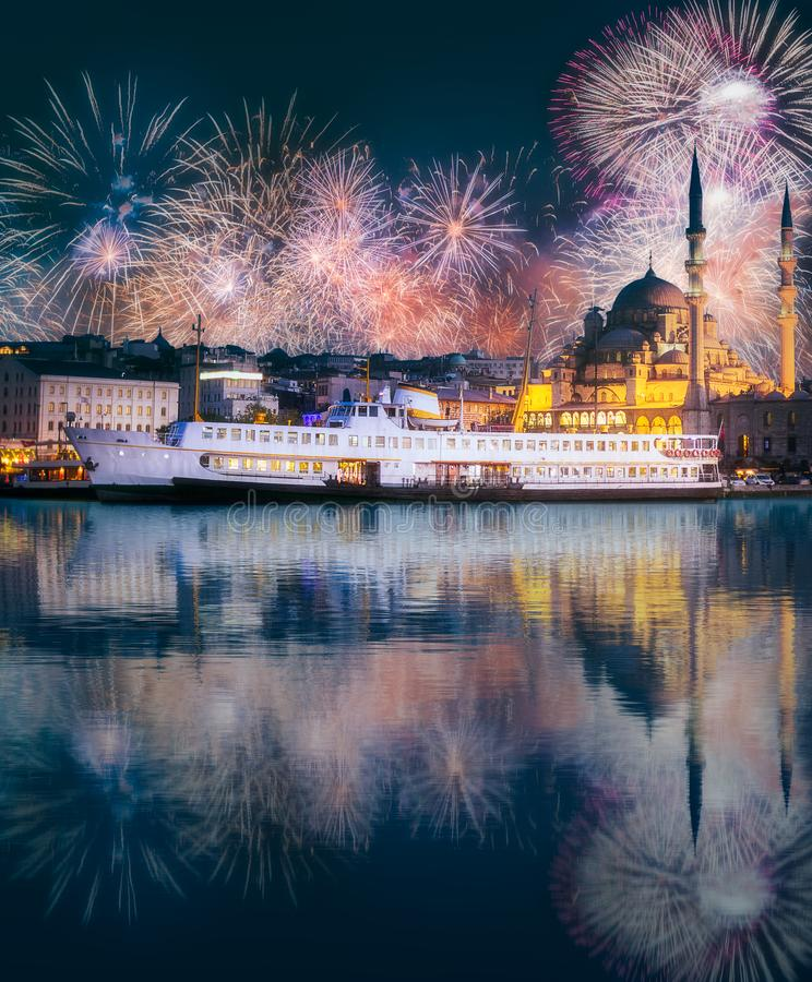 Beautiful fireworks above public ferry and old district of Istanbul. Beautiful fireworks above pier, public ferry and old district of Istanbul with Mosque on royalty free stock photo