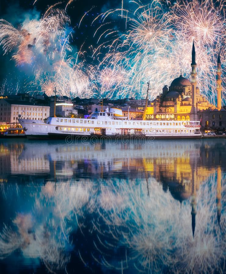 Beautiful fireworks above public ferry and old district of Istanbul. Beautiful fireworks above pier, public ferry and old district of Istanbul with Mosque on stock images
