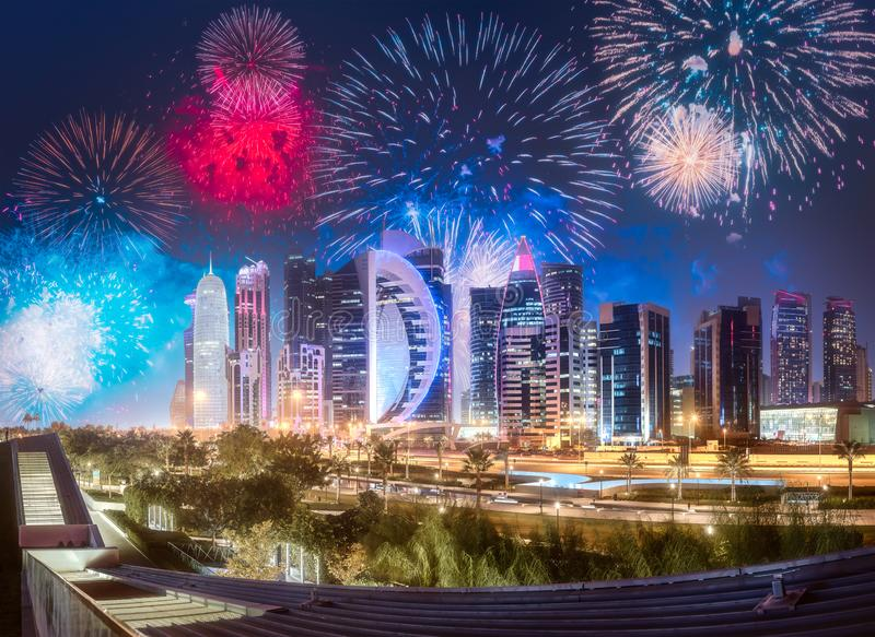 Beautiful fireworks above West Bay and Doha City, Qatar royalty free stock photos