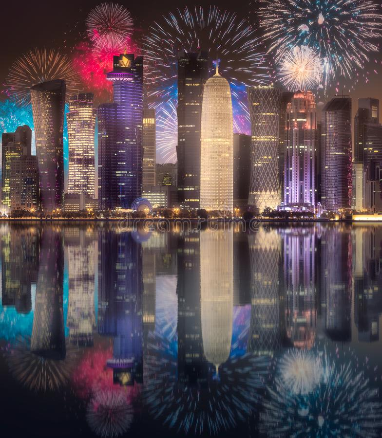 Beautiful fireworks above West Bay and Doha City, Qatar royalty free stock photo