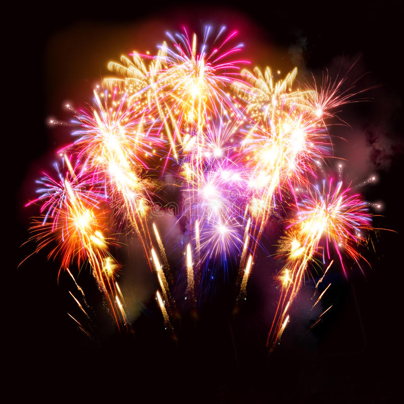 Beautiful Fireworks Display. Colourful golden and pink fireworks display for celebrations royalty free stock image