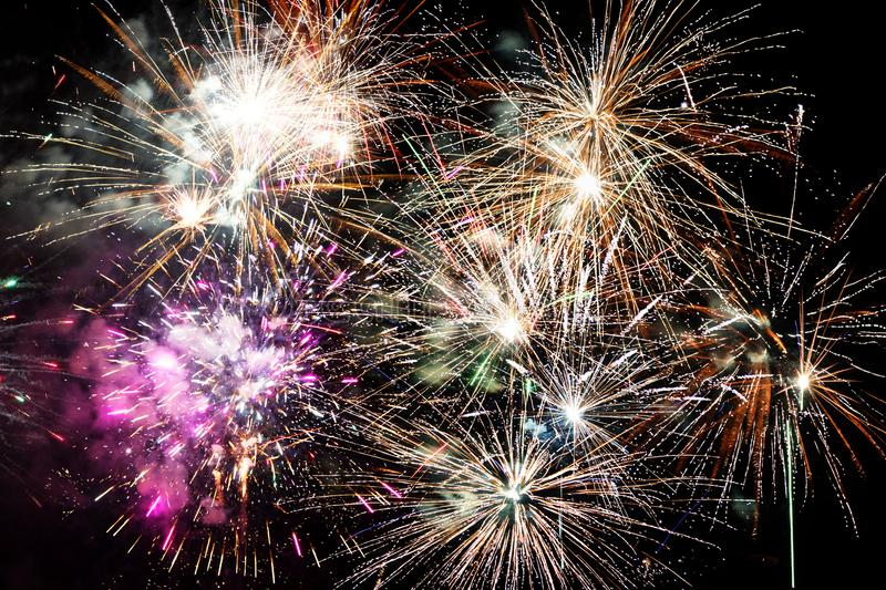 Beautiful fireworks explosions isolated on black background stock photography