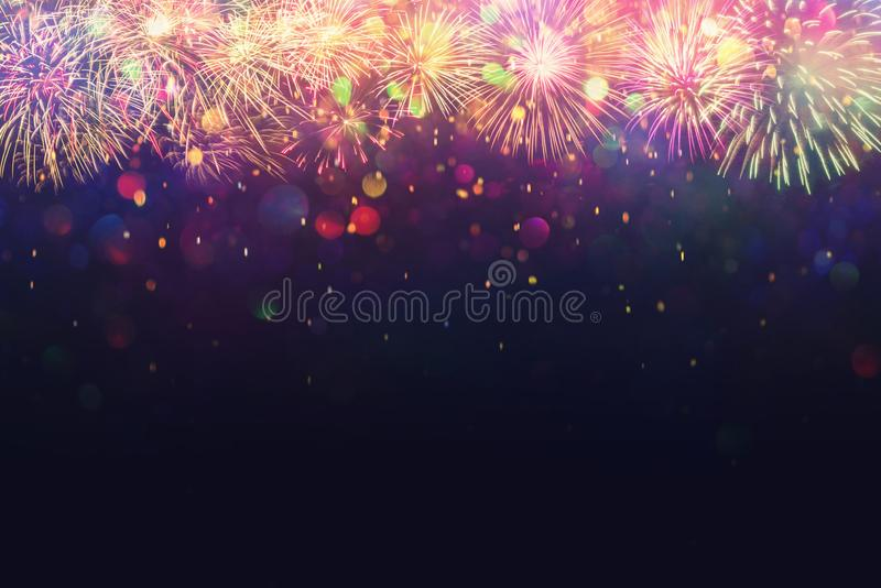 Beautiful fireworks and glitter bokeh lighting effect Colorfull Blurred abstract background for anniversary, new year eve or. Christmas royalty free stock photo