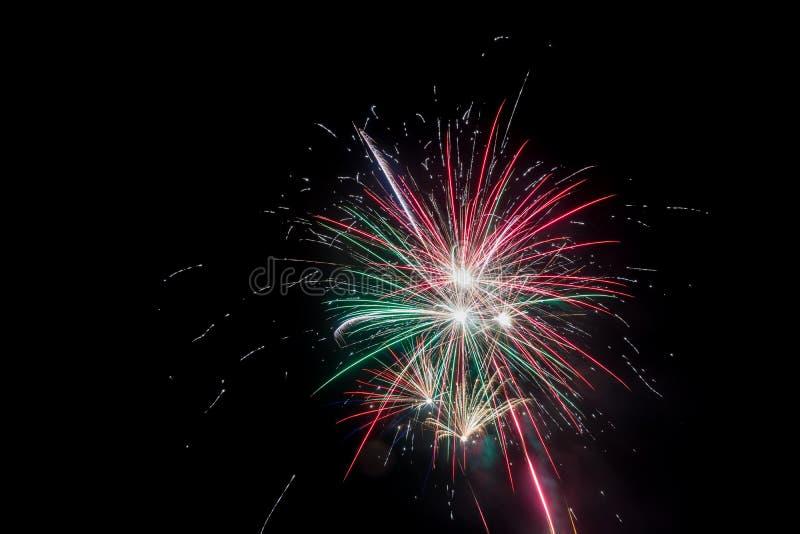 Beautiful fireworks at night. Festive fireworks display lit up over night sky. Celebration concept. Beautiful fireworks at night. Festive fireworks display lit royalty free stock photos