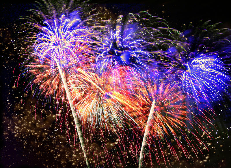 Beautiful fireworks in a night sky stock image