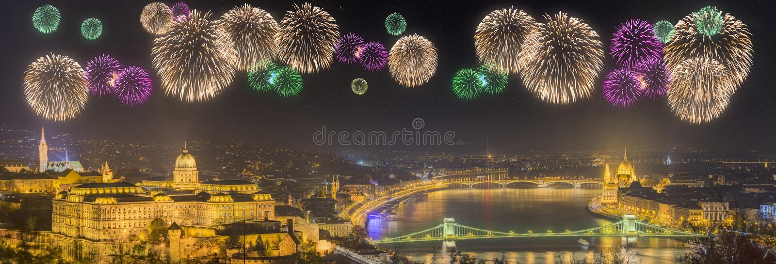 Beautiful fireworks under and cityscape of Budapest. Hungary, with the Chain Bridge, Parliament and Buda Castle royalty free stock images