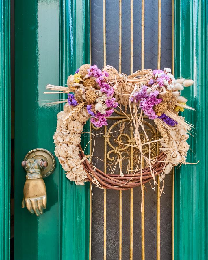 First of May wreath on vintage green door royalty free stock photos