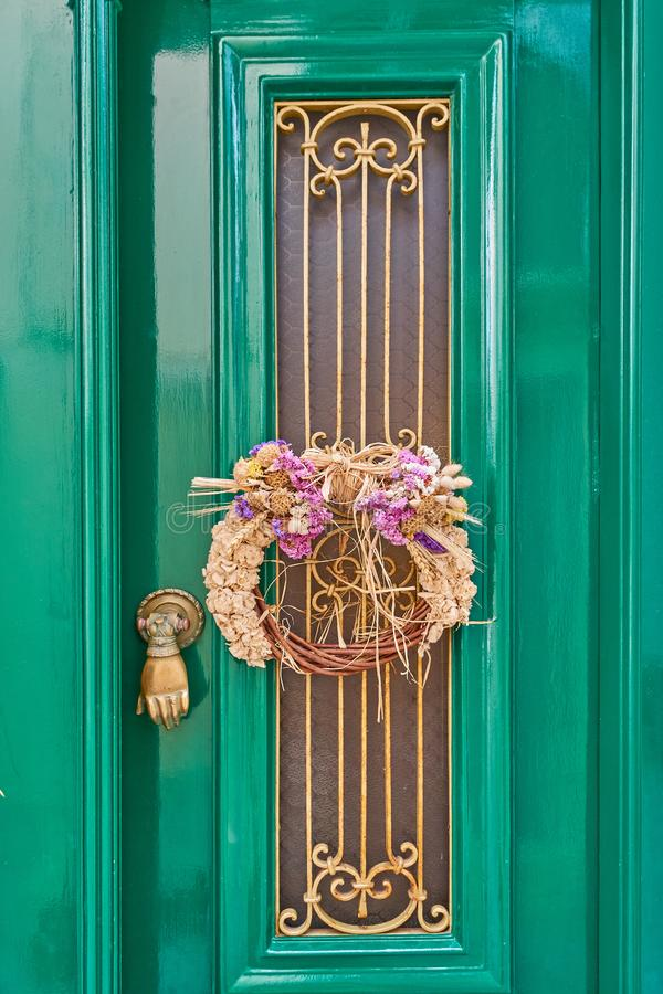 First of May wreath on vintage green door stock images