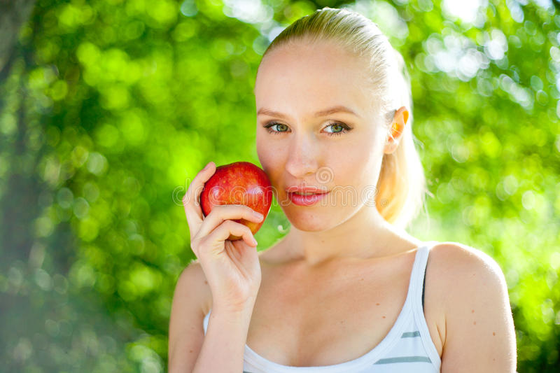Download Beautiful Fit And Healthy Woman Holding An Apple Stock Photo - Image: 25615096