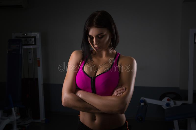 Beautiful fit thin slim toned female body jump rope athlete on dark standing confidently. Halthy concept royalty free stock image