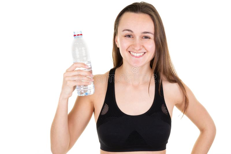 Beautiful fitness athlete young woman resting drinking water after sport gym stock image
