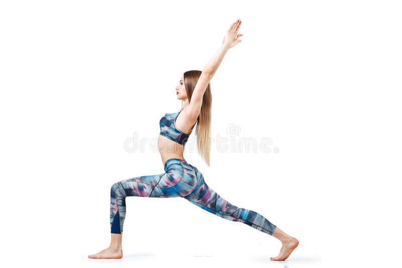 Beautiful fitness blonde woman stretches isolated on white background, isolated, Horizontal, full-length stock image
