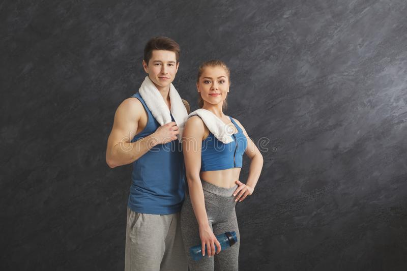 Beautiful fitness couple standing at gym royalty free stock images
