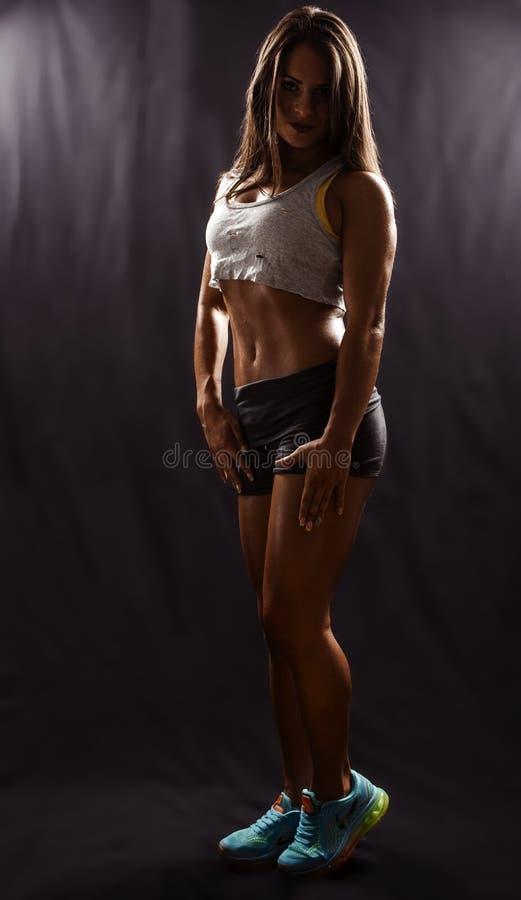 Beautiful fitness model posing stock photography