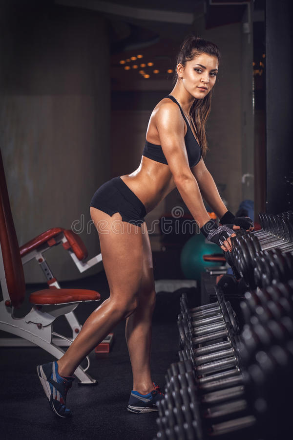 Beautiful fitness sport muscular girl in the gym royalty free stock photos