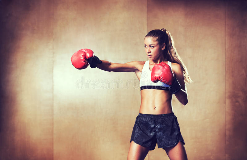Beautiful Fitness Woman Boxing with Red Gloves royalty free stock photos