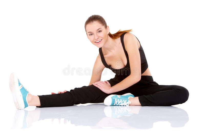 Beautiful Fitness Woman Doing Stretching Exercise Royalty Free Stock Photo